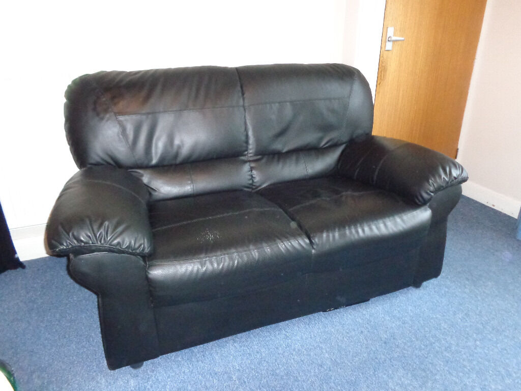2 Black Sofas - 2 seaters - Only £45