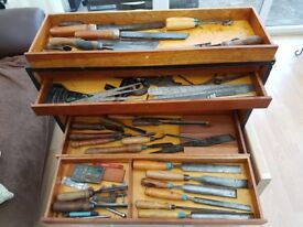 Wooden drawer set containing carpentry and wood working tools