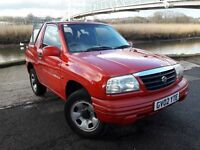 READY FOR SPRING WITH THIS 4X4 SUZUKI VITARA WITH ONLY 78K MILES...BRIGHT RED WITH BLACK VINYL ROOF