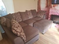 Corner sofa with scatter cushions and stool