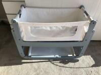 Grey Snuzpod with two mattresses and two fitted sheets