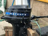Mercury 4.5 hp outboard boat engine with separate fuel tank.