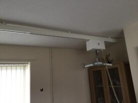 Ceiling hoist with instruction book. Buyer would have to dismantle it and take it away.