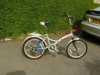 folding bicycle ladies or gents 20 inch wheels seven gears used but in showroom condition