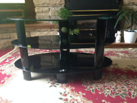 Black glass oval shaped tv stand