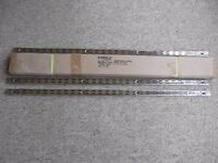 Unopened box of 10 new chrome-plated twin slot shelving uprights - 950mm long