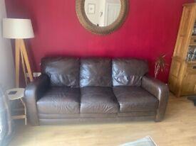 3 seat, brown leather sofa.