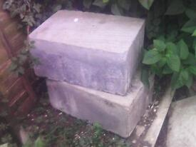 Two grey coloured breeze blocks in good condition.