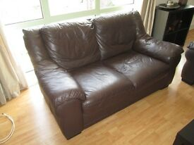 Two brown faux leather sofas