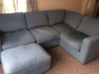 Less than a year old corner sofa and footstool with storage