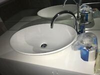 oval sink with tap