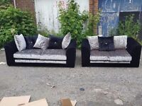 Stunning black and silver crushed velvet sofa suite. 3 and 2 seaters. 1 month old.can deliver