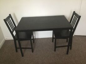 Ikea Tarendo dining table with two Stefan chairs