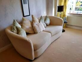 Large cream fabric sofa