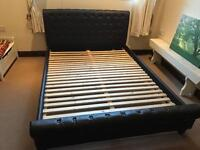 Dark brown leather king size bed