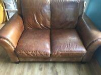 Italian Leather two-seater sofa.
