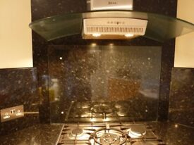 Clear Glazed Splashback with stainless connectors 900wide x 640 high