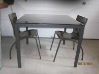 eq3 table and 2 chairs