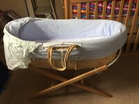 Very good condition baby Moses basket and toys