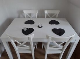 WHITE IKEA DINING TABLE (SEATS 4-8) EXTENDABLE