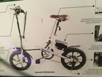 NEW UNUSED 2 x Kwikfold ELECTRIC Cycles, both white, withbrown leather seats and handle bars