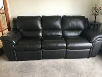Brown leather sofa with rocker recliner seat