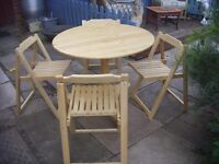 light pine dining table and chairs ( fold up) space saving
