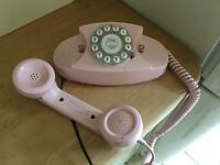 1950s style pink princess telephone