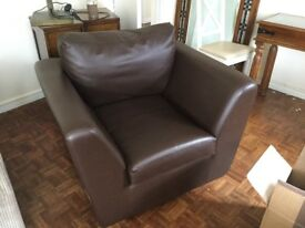 Brown, faux leather armchairs