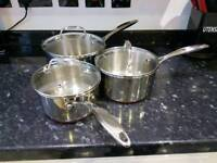 Set of 3 copper bottomed stainless steel saucepan