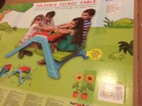 Brand new folding picnic table