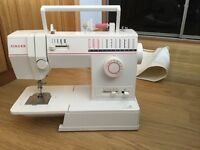 Singer sewing machine in good working order,only selling as purchased a new one