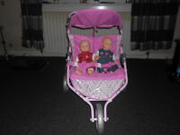 Double Baby Buggy with twin crying laughing dolls