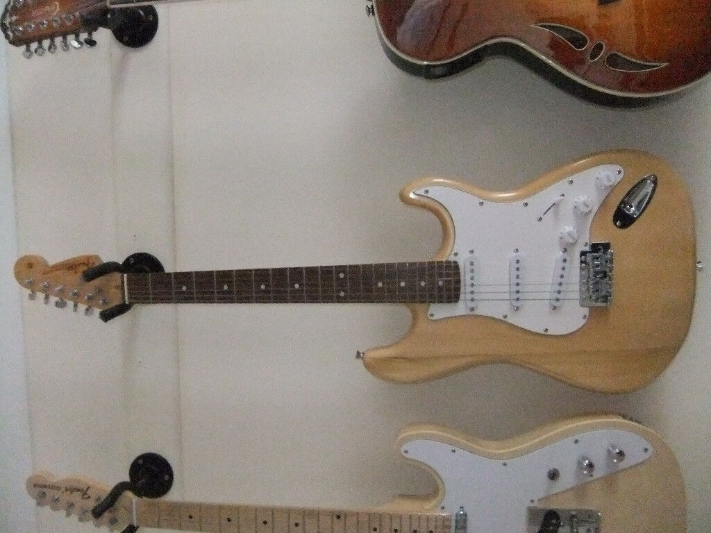 Copy Fender stratocaster with tremelo bar. Nicely set up with easy action.