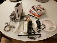 Nintendo Wii plus accessories with Games.