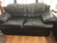 Black 2 and 3 seater leather sofa in very good condition