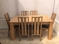Oak dining room table and 6 brown leather chairs