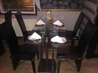 Glass tables and chairs for sale.