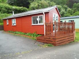 Wooden Chalet in Prime Position with parking for two cars at Clarach Bay Aberystwyth Wales