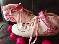 Pink and white Roller skates. Size 4.