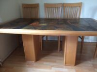 Dansk beech wood and slate dining table and ix chairs.