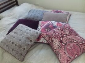 Pretty cushions 7 of them in various shades of mauve and plum. Excellent condition