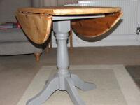 Round drop leaf pedestal table