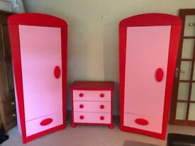 Two children's wardrobes with matching chest of drawers.