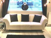 Cream(Ivory)Leather Suite. 3 Seater and 2 Seater Sofas. 3 + 2. £120.