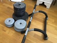 SET OF WEIGHTS WITH LIFTING BAR-YORK BARBELL & MARCY
