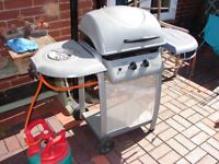 B&Q Laguna 2 burner gas BBQ with gas bottle.
