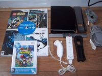 Black Nintendo Wii with games