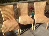 Six wicker dining chairs in good condition