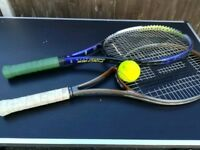 2 tennis rackets and 2 balls.